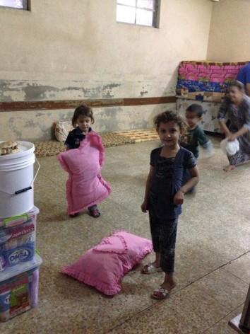 Escuela convertida en campamento para refugiados en Erbil, la capital del Kurdistán iraquí, en septiembre. Crédito: Annabell Van den Berghe/IPS