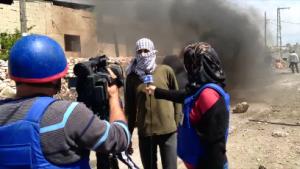 Periodistas palestinos en la línea de fuego. Crédito: Mel Frykberg / IPS