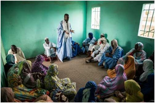 Imam Telmidy raises awareness about the dangers of child marriage to women. Credit: World Bank/Vincent Tremeau